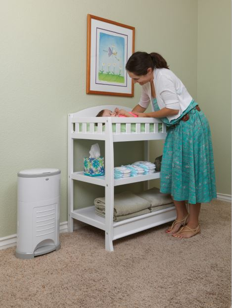 mom changing baby's nappy with korbell bin
