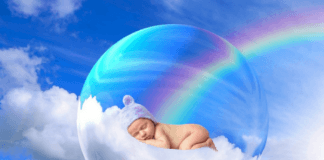 baby sleeping on a cloud in a bubble floating in the sky