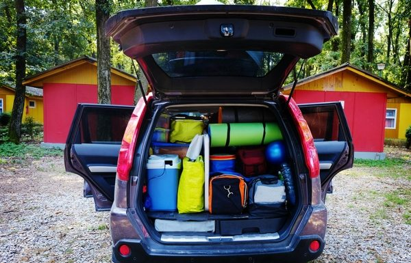 boot of car packed with holiday bags and equipment