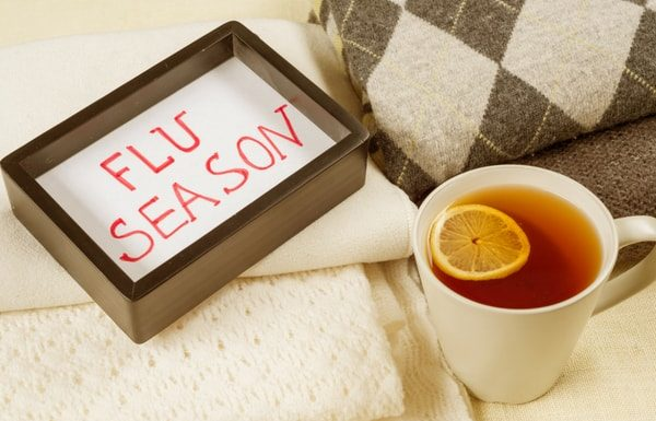 flu season with cup of lemon tea with cream blankets-min
