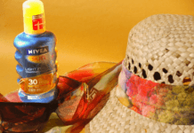 nivea sun screen and sun hat with sunglasses