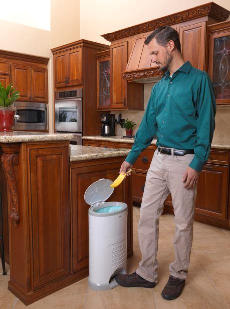 man using a korbell bin as a dustbin