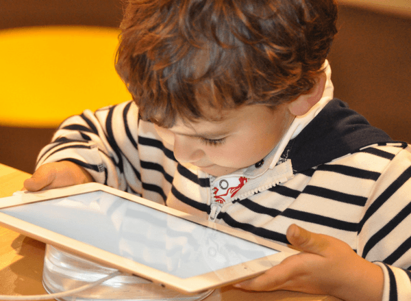 young boy looking at tablet