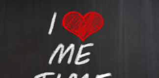 chalk board with I love me time written on it