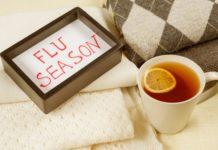 flu season with cup of lemon tea with cream blankets-min