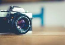 minolta camera lens on desk