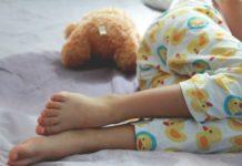 preschooler bedwetting with teddy in duck pajamas-min