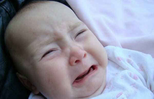 baby with colic crying