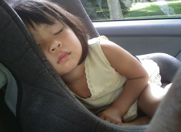 child sleeping in car seat about to end in tragedy on the road