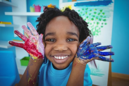 happy special needs child painting and crafts