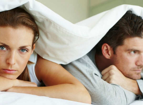 man and woman not talking to each other due to his decreased sexual libido