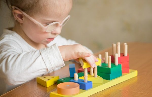 special needs child playing with toy
