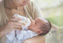 mother formula feeding her baby