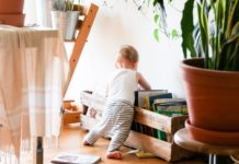 child-looking-through-books-to-read