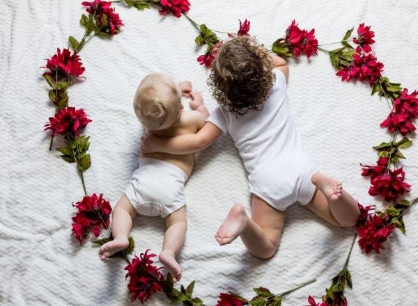 siblings-on-bed-in-flower-heart