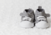 black and white image of a pair of baby shoes