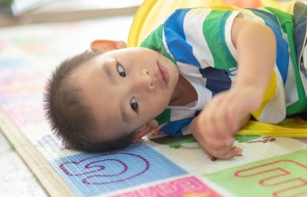 autistic-child-on-play-mat