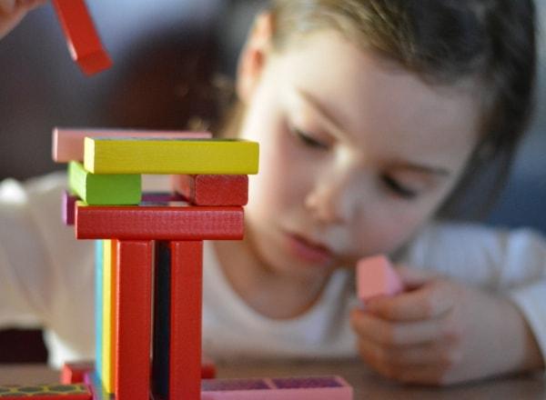 child-using-play-blocks