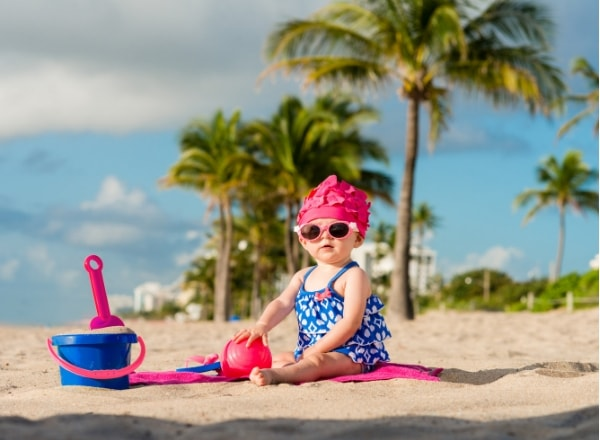 baby-on-beach-with-bucket-and-spade