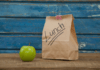paper lunch bag with an apple
