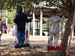 children-learning-while-playing-on-swings