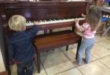children-playing-with-a-piano
