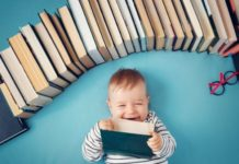 parenting-books-for-parents-baby-holding-book