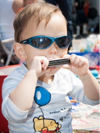 toddler-wearing-sunglasses-playing-harmonica