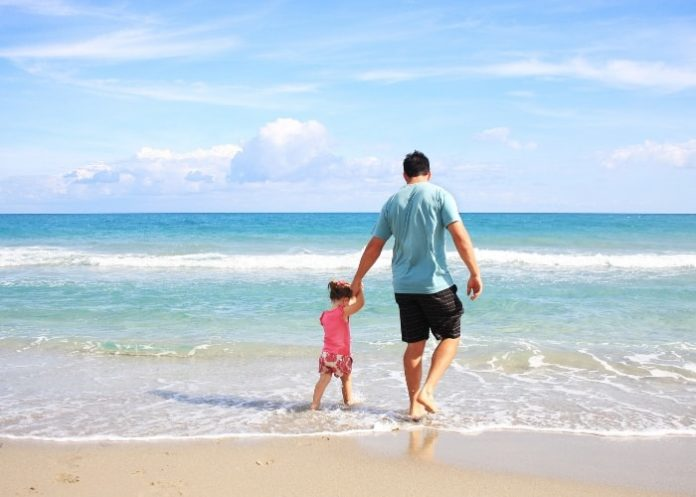 dad-on-the-beach-with-child-sunny-safe-day