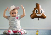 toddler-with-poo-emoji-balloon