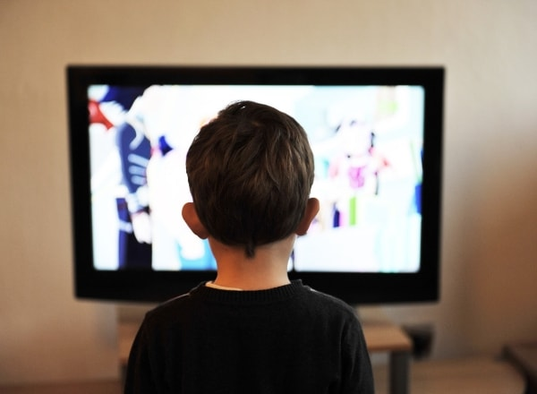 child-watching-tv-that-is-digitally-literate