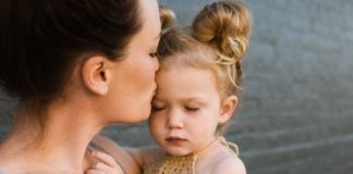 good-enough-mother-kissing-daughter-on-forehead