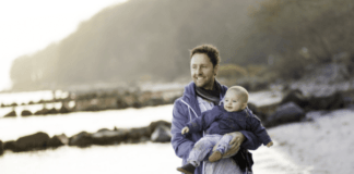 happy-dad-with-baby-on-the-beach