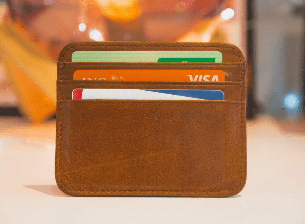 brown-wallet-with-bank-cards-savings-month