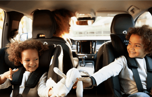 children-in-rear-facing-car-seat-playing