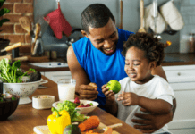 dad-and-child-eating-fruit-and-vegetables