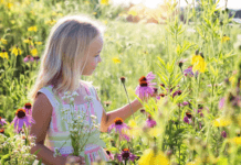 little-girl-in-garden-environment-flowers