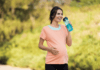 pregnant-woman-walking-exercise-drinking-water