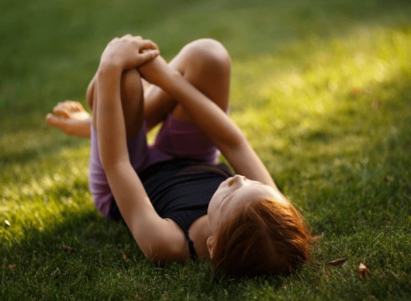 preschooler-reconnecting-with-nature-lying-on-the-grass-bliss
