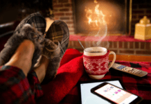 sitting-infront-of-a-fireplace-in-slippers-with-coffee-warm