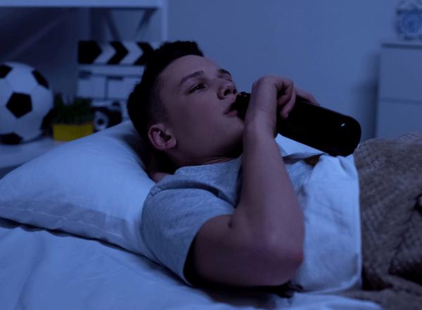 teen-drinking-alcohol-beer-in-bedroom