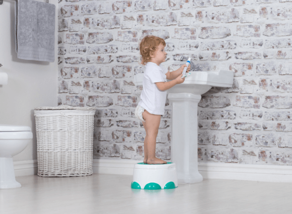 bumbo-step-n-potty-standing-to-reach-basin-in-bathroom
