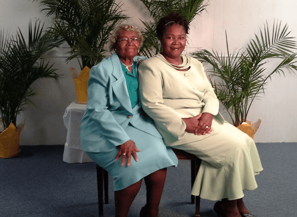 grandmother-mom-with-her-daughter-sitting-for-a-photo-portrait-after-giving-financial-advice