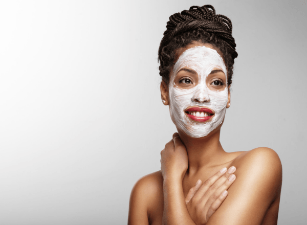 Woman applying a DIY homemade face mask using ingredient you already have at home