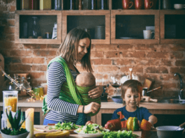 mother-with-gestational-diabetes-making-healthy-food-in-kitchen-with-baby-and-child
