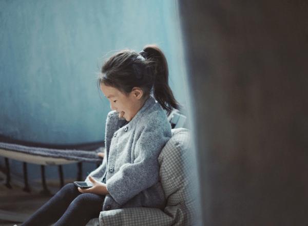 young-preschooler-girl-happily-using-smartphone-device