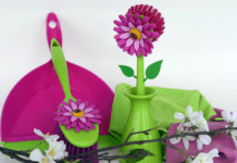 Colourful spring themed cleaning products and brushes