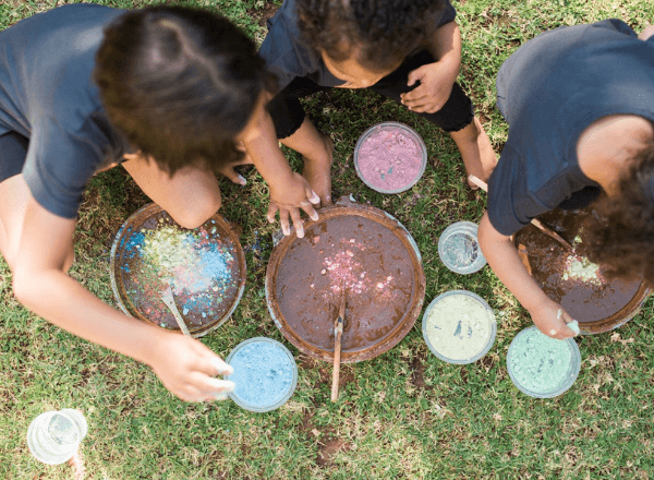 Children playing with mud in the garden