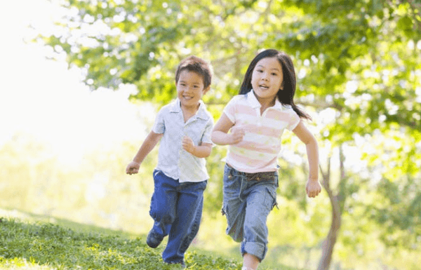 happy-children-running-in-green-field-outdoors-smiling-and-laughing