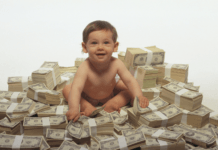 Baby sitting in huge pile of winning money